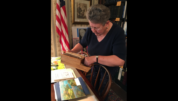 Photo provided - Rebecca Shank, historian at the Sue Silliman House in Three Rivers, explores photos of the St. Joseph River with documentary producers for WNIT.
