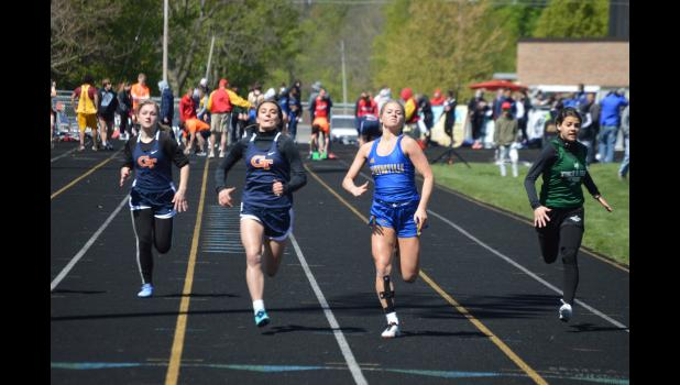 Commercial-News | Scott Hassinger - Gabrielle Bowen, left, from Centreville battles Mendon freshman Jozryl Meeks for first place in the girls' 100-meter dash in Saturday's Centreville Invitational.