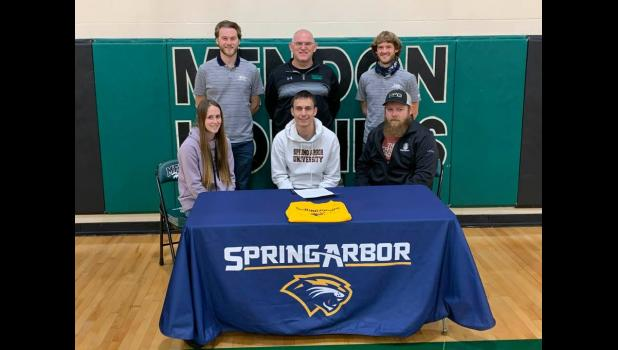 Commercial-News   Scott Hassinger Mendon High School's Charlie Newburry, seated in the middle, has signed a national letter of intent to run men's cross country and track and field at Spring Arbor University the next four years. Seated to Charlie's left is sister Kayla Lux and at far right  is Travis Lux; In back is Spring Arbor assistant men's cross country and track and field coach Kameron Mills, Mendon cross country coach Art Stephenson and Spring Arbor University head men's cross country and track and