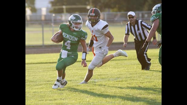 Photo provided  - Mendon senior quarterback Chris Dupree outruns a Fennville defender for a touchdown run in Friday night's home game.