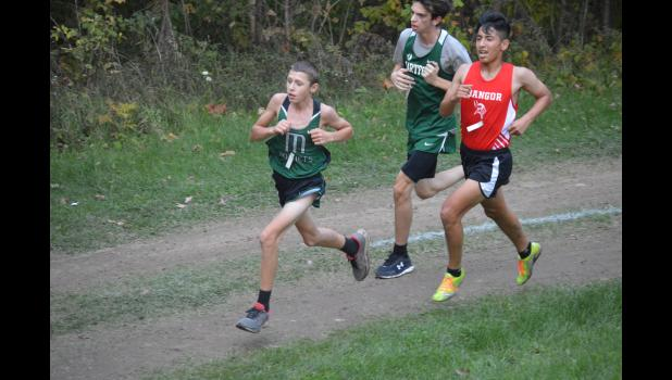Commercial-News | Scott Hassinger - Mendon's Landon Vanwormer tries to stay ahead of this pack of runners as he nears the end of the boys' race Wednesday.